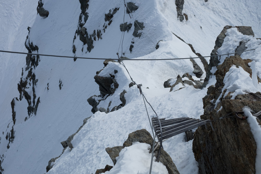 Looking down at a climbing route from the Jungfraujoch sphinx observatory tourist deck