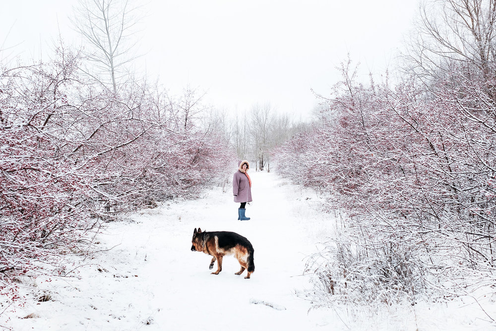 A woman with her dog along the Irtysh river in Omsk, Russia.