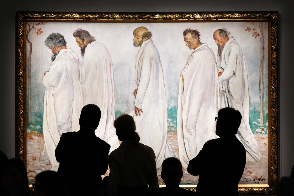 "Visitors in front of Ferdinand Hodler painting ""Eurythmie"" on display at the Rath museum in Geneva during the Hodler Parallelism temporary exhibition."
