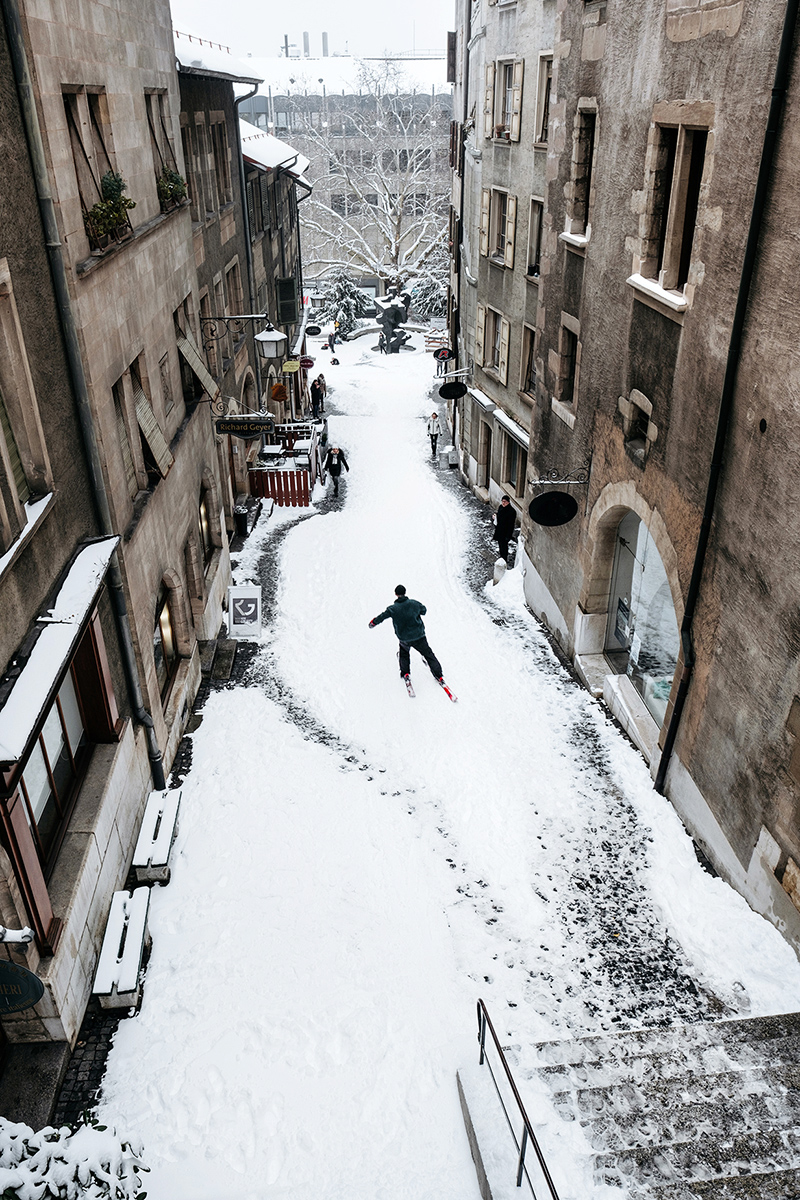 Skiing in the old town of Geneva, looking down at the Rue du Perron.