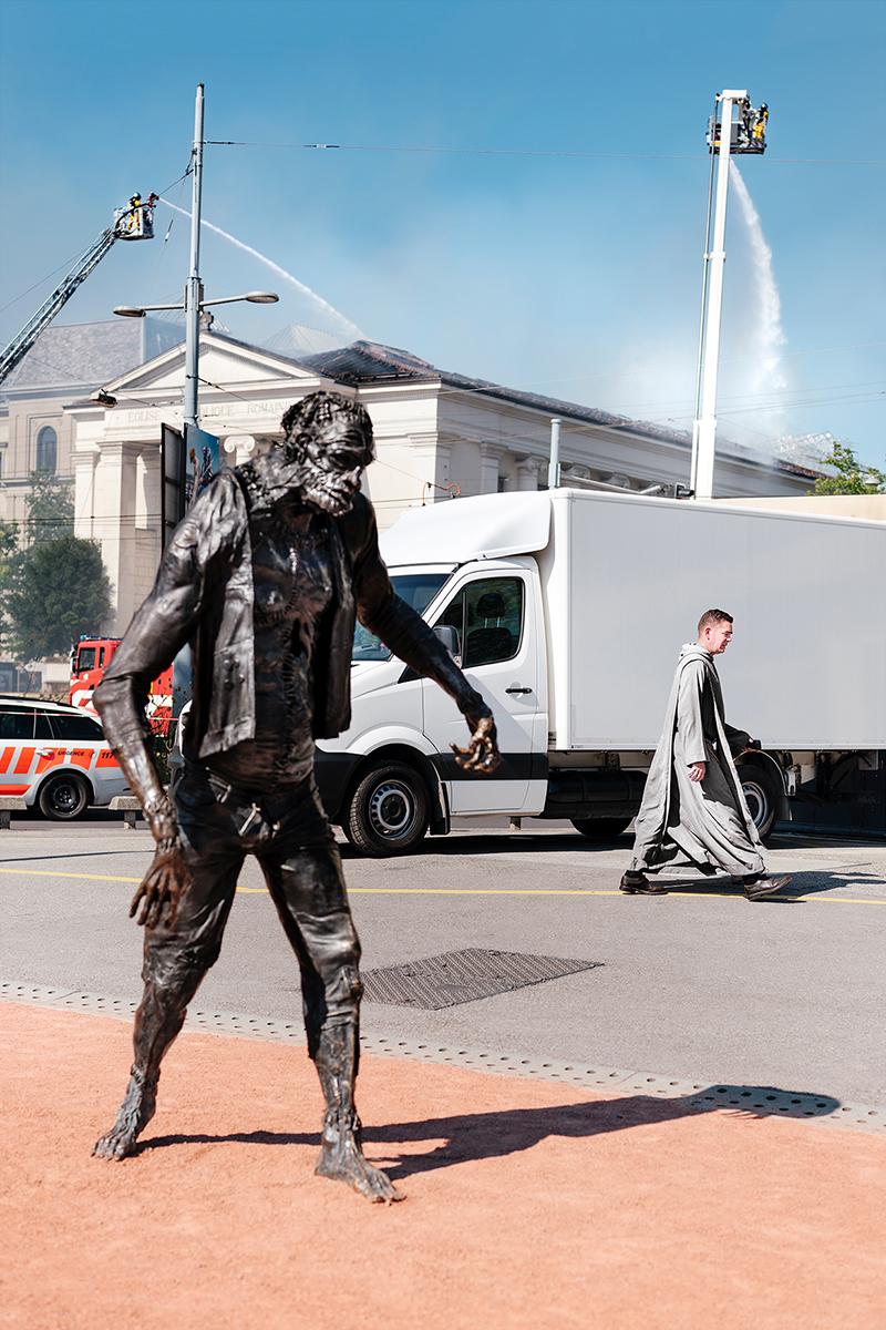 Frankenstein's monster in front of a burning church (L'Eglise du Sacré Coeur) in Plainpalais.