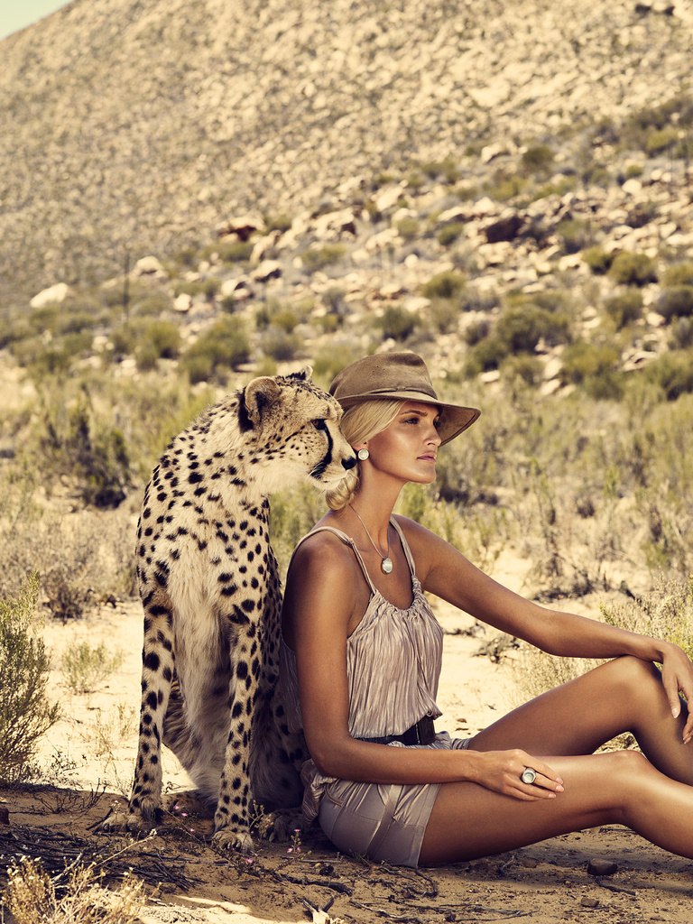 Anna & The Cheetah    One of my favs, this cheetah is actually untamed all though it is used to people since it lives inside Aguila game reserve in south africa. Here it is sitting besides Anna Krolicka.    Link to the whole gallery