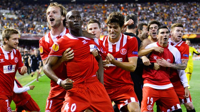 Stéphane Mbia (Sevilla FC)   Stéphane Mbia (3rd L) of Sevilla FC celebrates with team-mates after scoring their first goal during their UEFA Europa League semi-final second legagainst Valencia CF  - photo/caption from  www.uefa.com