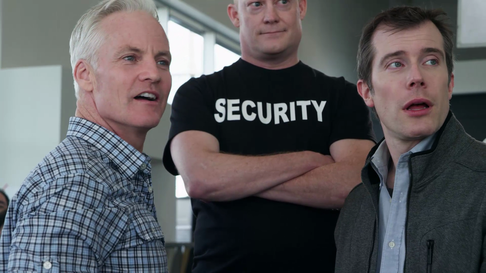 John Curley (left) and Adam Gherke run up against a security guard in the second series of SIFF Renton promos.