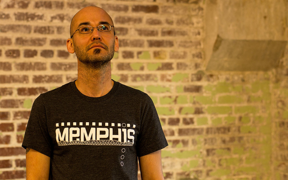 Me, wearing a Memphis Superstructure t-shirt in dark grey heather.