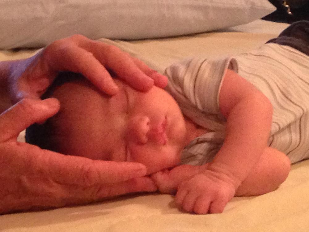 Baby Gavin receiving CranioSacral Therapy by Miranda Warburton, PhD, CMT, CST-D