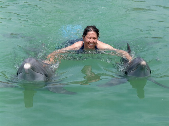 Jennifer with dolphins Robala and Coco after a day of CST in the water with the dolphins.  Freeport, Grand Bahama