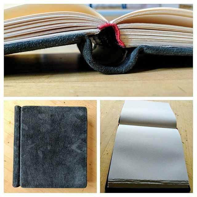 "A recently completed sketch book. My first time covering with ""rough goat"" which is just prepared so the flesh side is out. Springback binding, Velata 140gsm paper #bookbinding #springback #roughgoat"