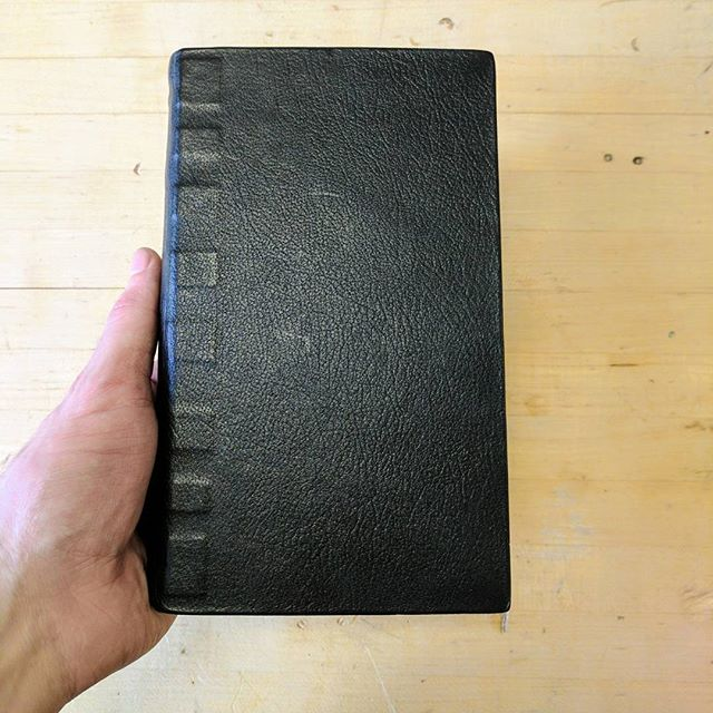 It's not book abuse, just a fantasticly flexible binding put to use. A tight parchment style binding finished in black goatskin. #goatskin #leather #bookmaking #bookbinding #AKAk-118 #tightparchment