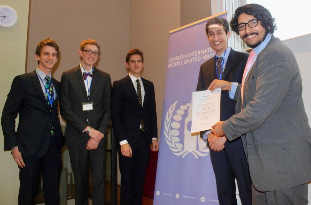 Receiving the award for 'Best Delegation' from Secretary General of the conference Tahmid Chowdhury. L-R: Eric, Nate, Nathan and Kieran.