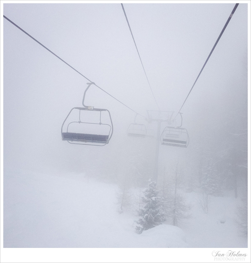 chairlifts in the clouds