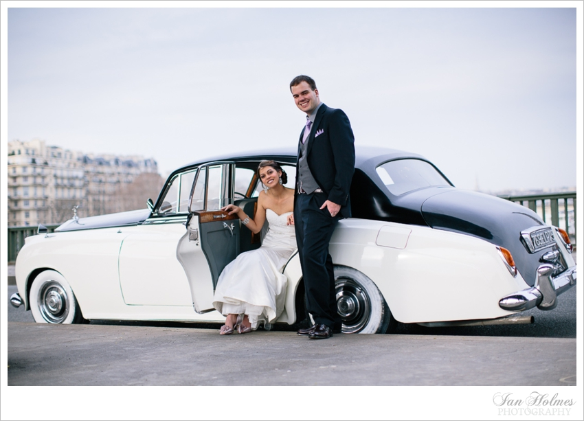 bride and groom in vintage rolls royce
