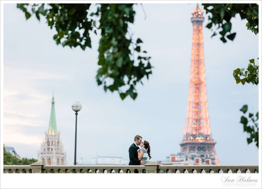 romantic couple in paris underneath the eiffel tower