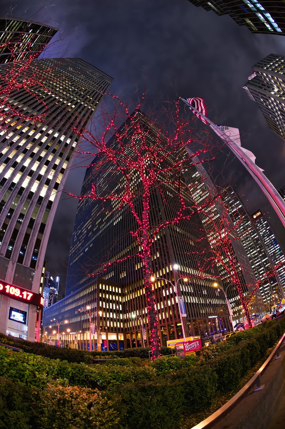 Avenue of the Americas, Manhattan with Christmas decorations on the trees.