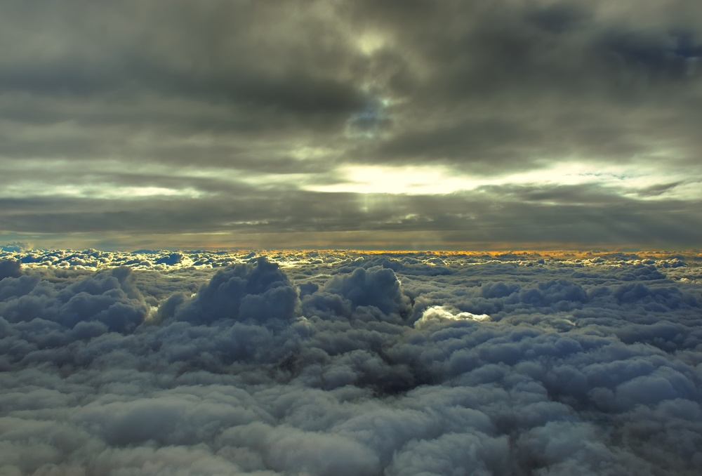 Just after take off from Fuimicino Airport in Rome, Italy. In between two cloud layers, climbing to cruising altitude in an Airbus A380.
