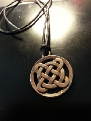 This stainless steel pendant was 3D printed using the corner knot square model in this mini-project.