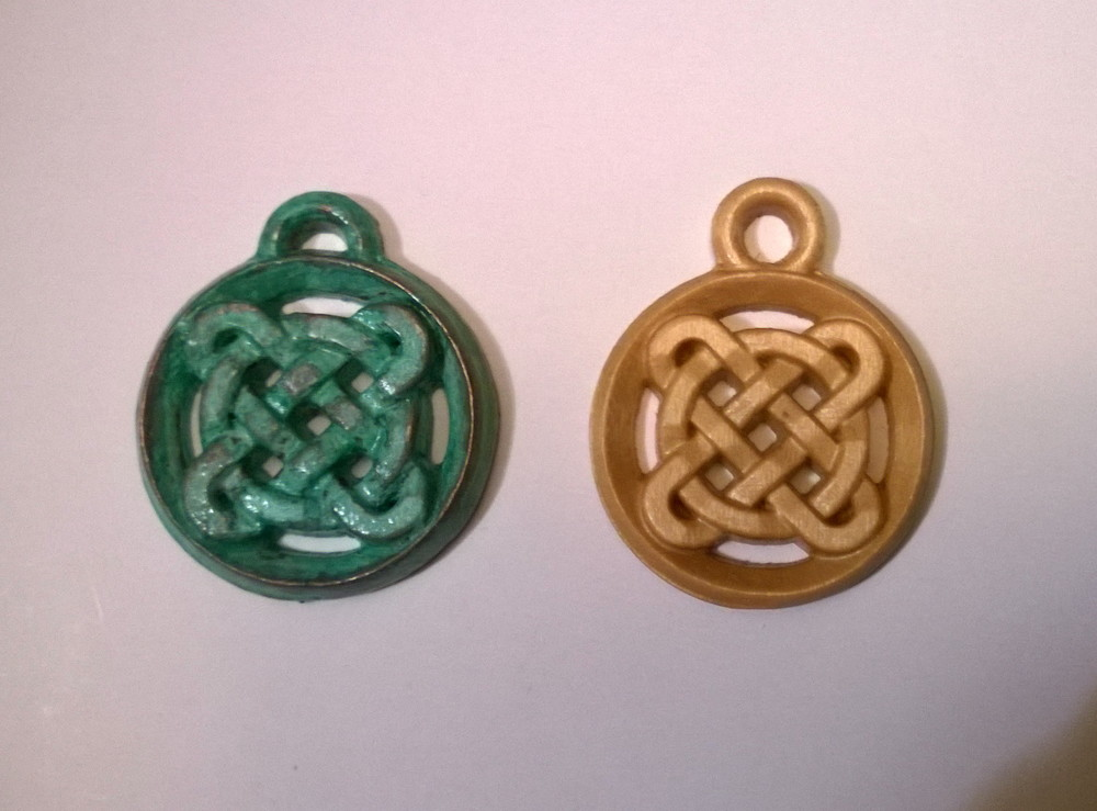 Thanks Mr. S for sharing this picture of a couple of wooden pendants created using this project!