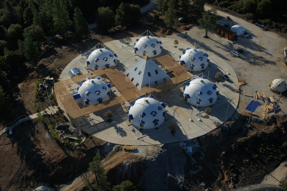Aerial view of the Shambhala Monastery - within the Circle are seven 51 Degree Pyramids forming a Six-pointed Shambhala Star with a large 51 Degree Teaching Pyramid at the Center that includes a full crystal pyramid within and a large Solar Orb above the capstone.