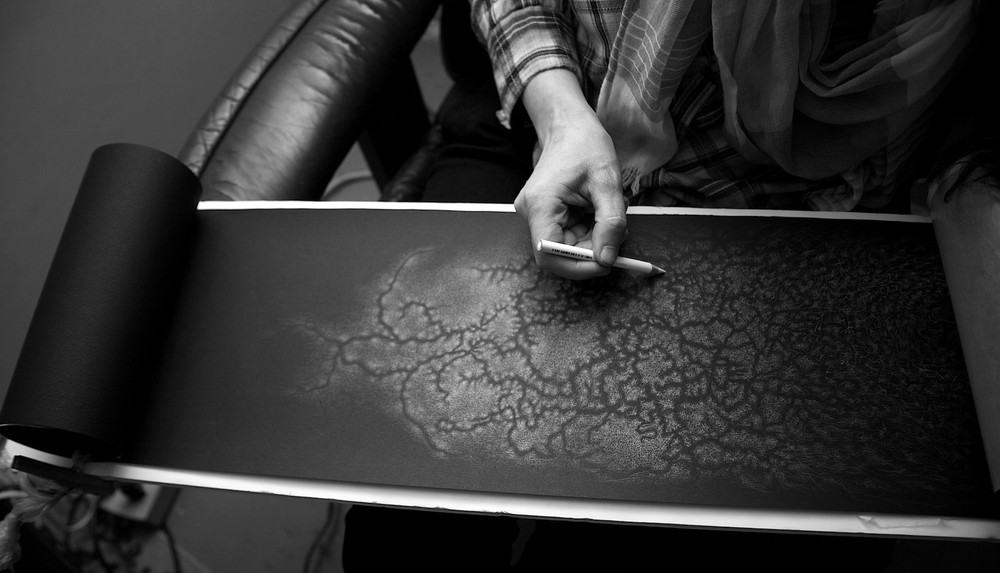 Bette Burgoyne working on a segment of her scroll drawing, 'Forest'.