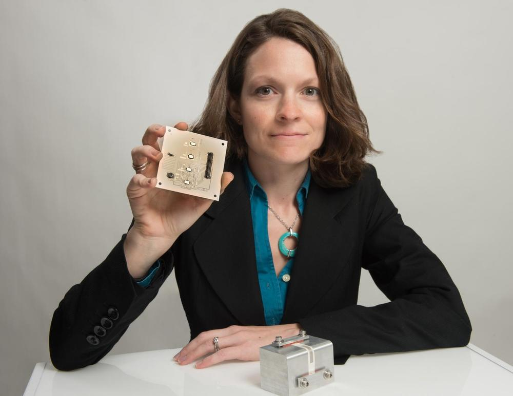 NASA Goddard technologist Beth Paquette shows a 3D printed object including circuit paths