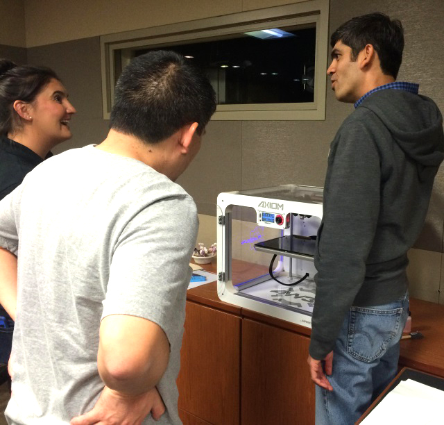 Individuals happily discovering 3D printing at Airwolf's Warner Bros. 3D print event