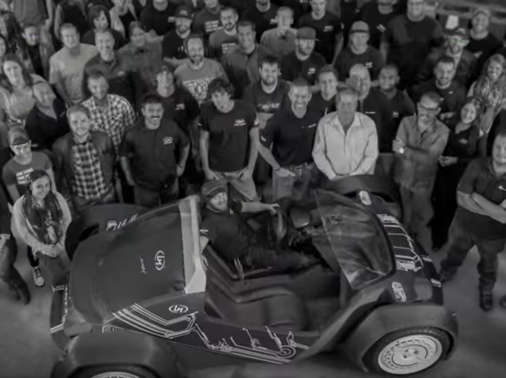 A crowd around Local Motors' LM3D