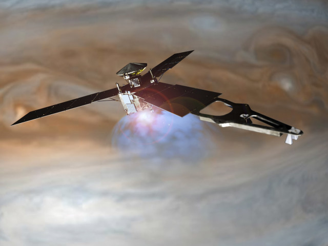 An illustration of the Juno spacecraft in orbit around Jupiter. (Image courtesy of Lockheed Martin.)