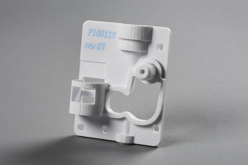 "A sample part from the Rize One 3D printer with an identifying label ""inked"" on the surface"