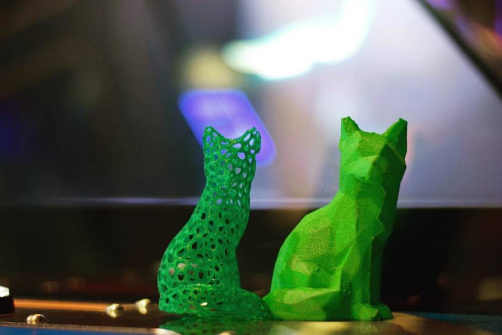 Two green foxes