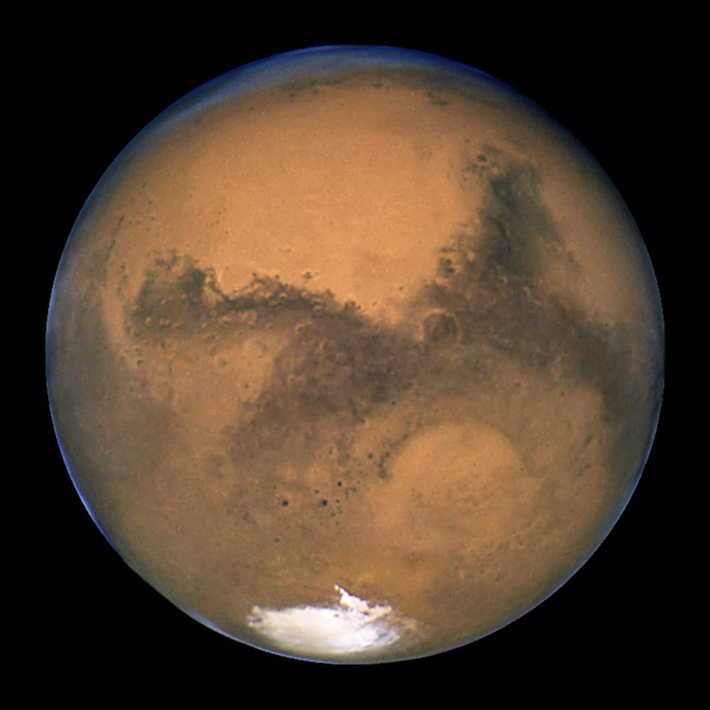 Mars showing its unique colors, courtesy of the Hubble Space Telescope