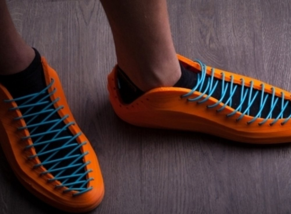 Wearing 3D printed shoes after lacing them up