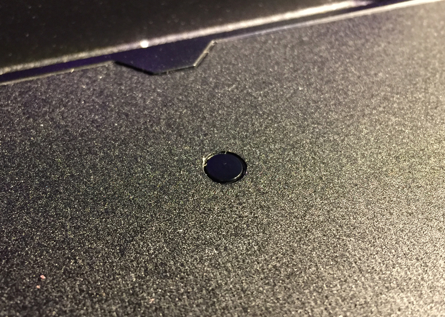 "One of several small ""buttons"" on the MakerBot Replicator+ build plate"