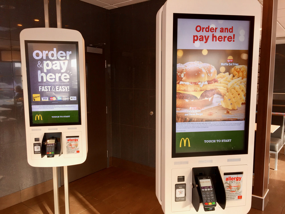 Automated order-taking devices at a McDonalds