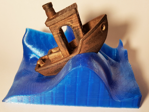 A #3DBenchy print resting on the Wave Stand