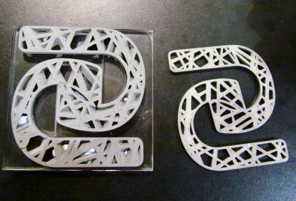 """A """"green"""" part on the left, and the corresponding sintered metal 3D print on the right"""