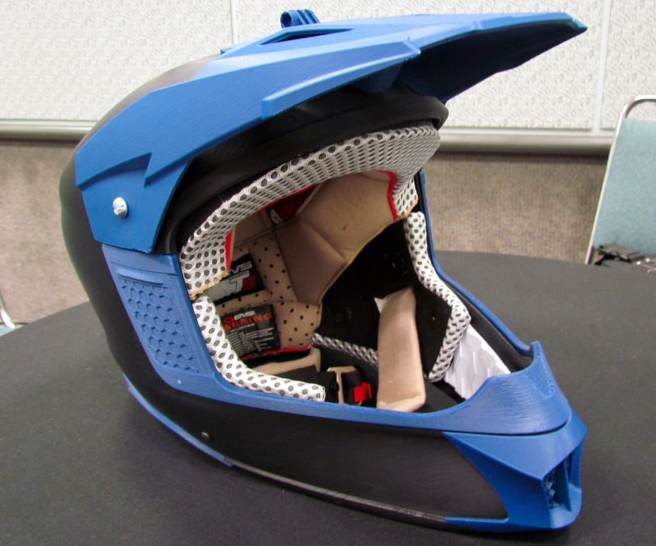 A prototype helmet produced by CADPD on the Stratasys F370 3D printer. Note screws were inserted without requiring any drilling
