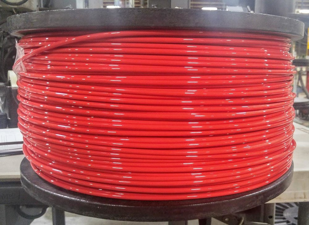 A spool of 5mm diameter 3D printer filament