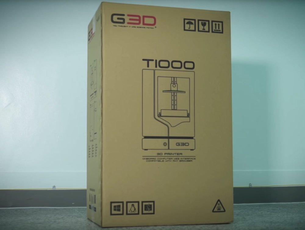 A T-1000 desktop 3D printer boxed and ready for shipping