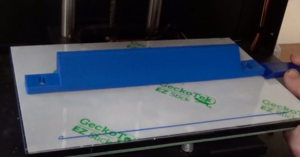 A pathological 3D print that has stuck properly to the build plate on GeckTek's EZ Stick