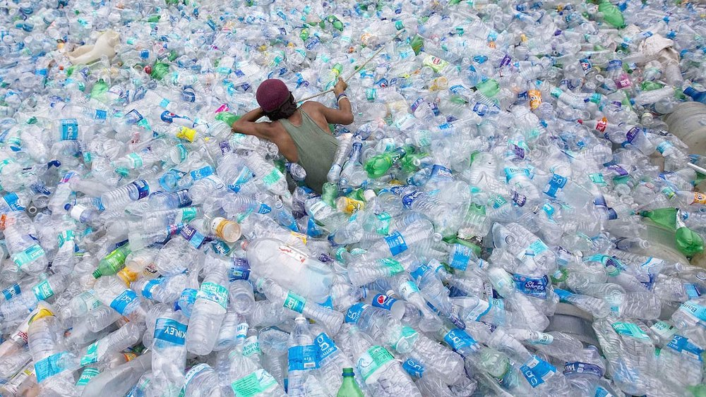 Swimming in a sea of discarded plastic bottles, looking for 3D printer feedstock