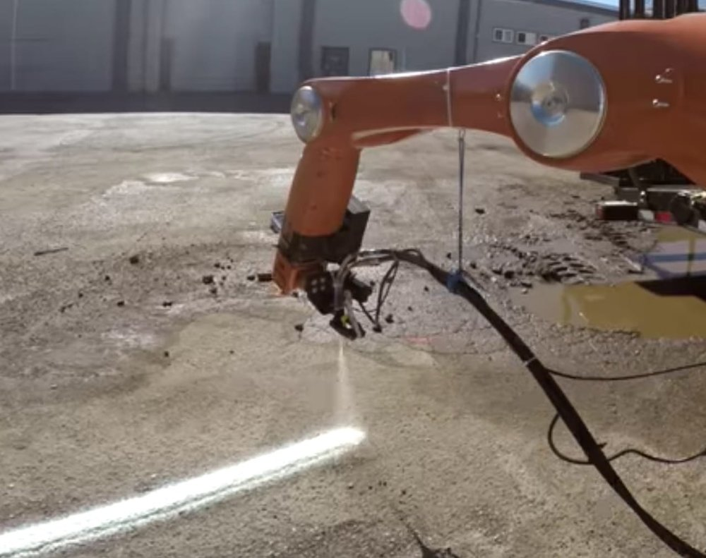 MIT's 3D printed building concept involves a Kuka robot arm spraying material directly on the surface