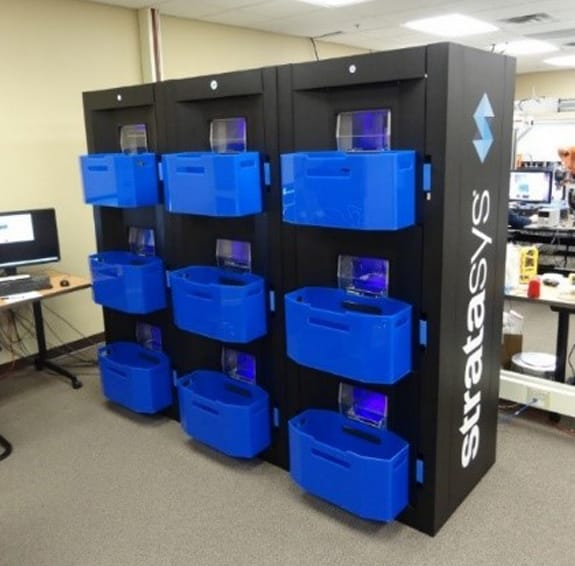 Stratasys' new continuous 3D printing concept demonstrator. Note blue bins to catch prints!