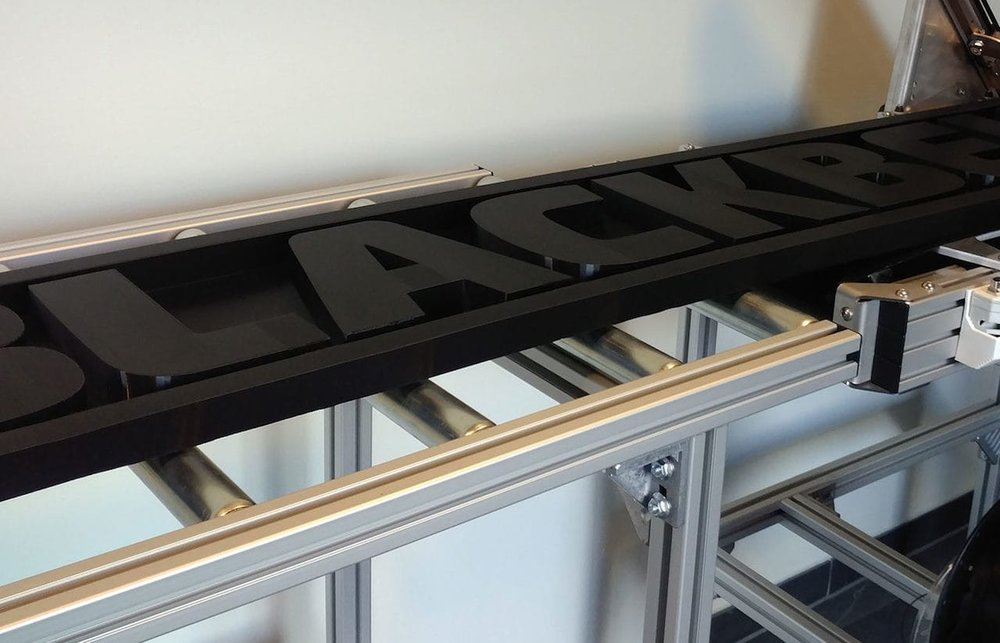 A rather lengthy 3D printed sign coming off the Blackbelt 3D printer
