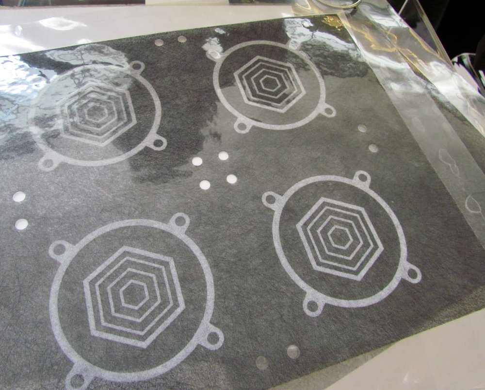 An in-progress composite sheet being used in the Impossible Objects 3D printer