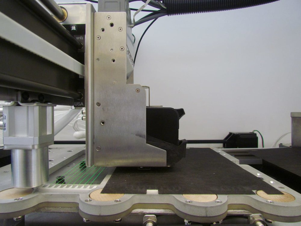 Inside the Impossible Objects composite 3D printer