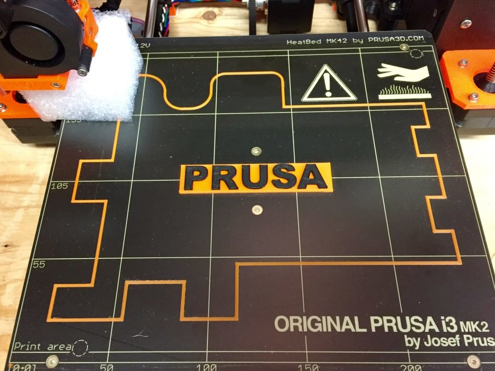 The factory print remains on the bed of the Original Pruse i3 desktop 3D printer