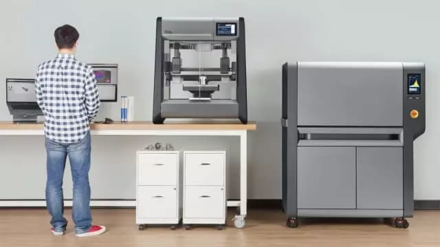 The DM Studio System is described as the first office-friendly metal 3D printer. On the right is the microwave-enhanced sintering furnace. (Image courtesy of Desktop Metal.)