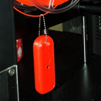 Mister Screamer hangs from your filament during operation