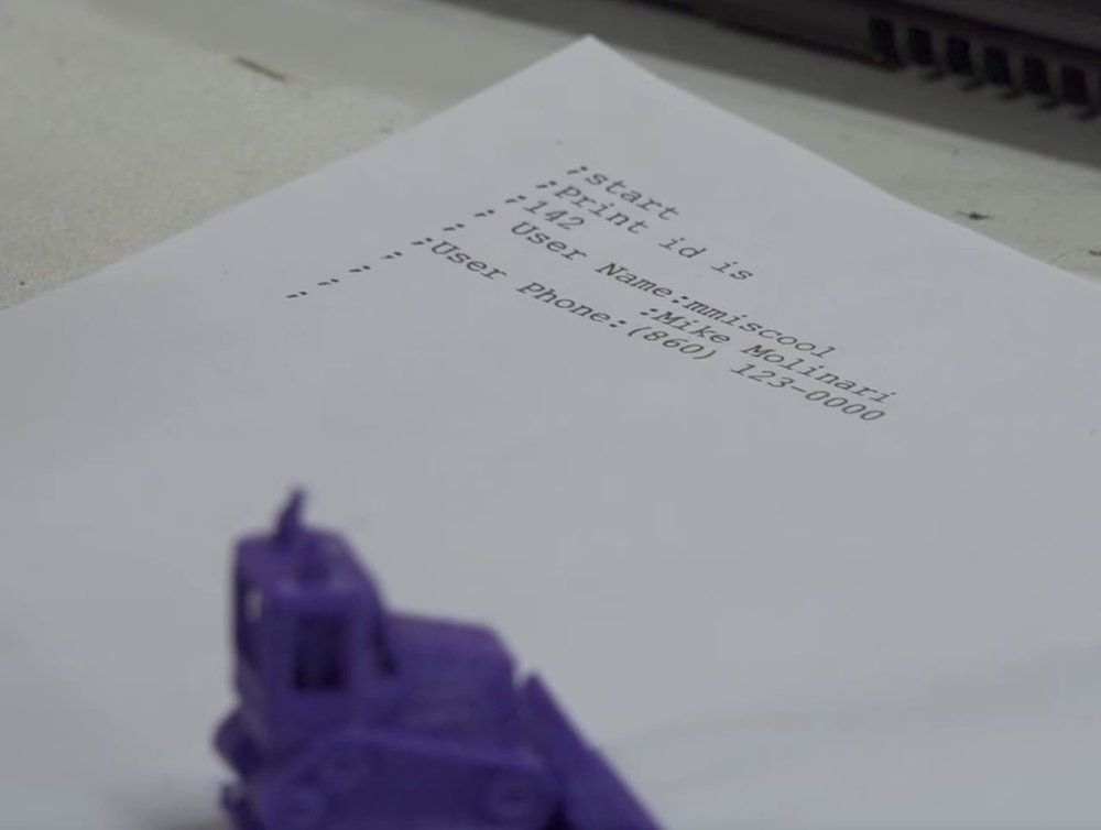 An object 3D printed on a labelled piece of paper