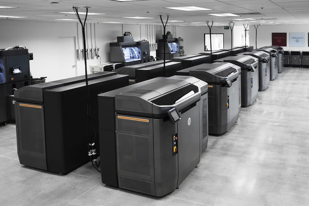 A bank of HP 4200 production 3D printers at a new customer site